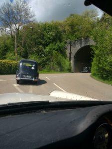 Wolseley New Fourteen leading more classics under a railway bridgeg