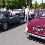 A rear view of Wolseley 1500 and E Type Jaguar